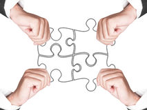 Business hands and puzzle isolated Royalty Free Stock Image