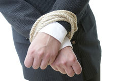 Business hands and rope 3. Close up of businesswoman hands tied with rope Royalty Free Stock Image