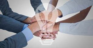 Business hands together with white lightbulb graphic Royalty Free Stock Image