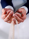 Business hands trying to hold sand. Male business hands trying to hold sand Royalty Free Stock Images