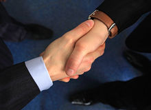Business handshake. A business handshake is in an office Stock Image