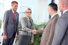 Business handshake. Business people shakinng hands over a deal Royalty Free Stock Photos