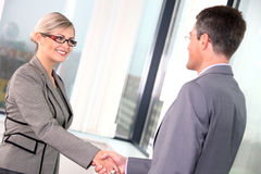 Business handshake. Business women and businessmen shaking hands over a deal Royalty Free Stock Photography