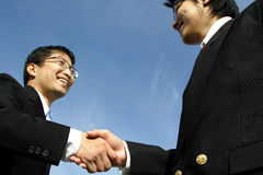Business handshake. Two businessmen shaking hands ( focus on the hand Stock Image