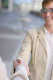 Business handshake. Business woman shaking hands with another person Royalty Free Stock Image