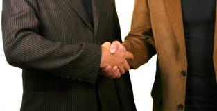 Business Handshake. Two you businessmen shaking hands. Isolated studio shot Stock Image