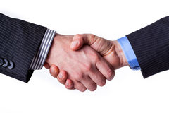 Business handshake. Busines handshake with a promise of partnership Stock Image