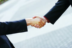 Business handshake. Close up of handshake between two businessmen Royalty Free Stock Photo