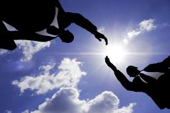 Business handshake. Special lens flare f/x (silhouette made from my photos Royalty Free Stock Photo