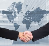 Business handshake. Conceptual image: Man and woman are shaking hands after a business deal Stock Images