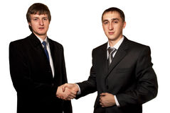 Business handshake. Two business man on a white background Royalty Free Stock Photo