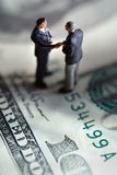 Business handshake. On a dollar stock photo