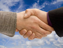 Business handshake. Man and woman business handshake stock photo