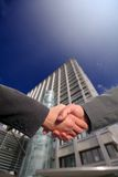 Business handshake. Background an office block Stock Image
