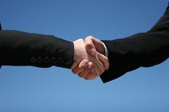 Business handshake. Young girl and guy handshaking for business Royalty Free Stock Photo