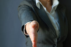 Business handshake. The young businesswoman hold out hand Royalty Free Stock Photos