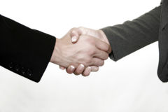 Business Handshake. A Business Handshake with a male and female in black and grey business suits Royalty Free Stock Photography