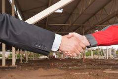Business handshake. On construction site of shopping center Royalty Free Stock Images