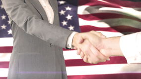 Business handshake against american flag. Digital composite of Business handshake against american flag stock video