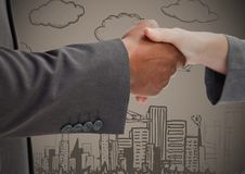 Business handshake against brown background with city doodles. Digital composite of Business handshake against brown background with city doodles Stock Photos