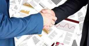 Business handshake against document backdrop stock photos