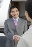 Business Handshake At Airfield Stock Photo