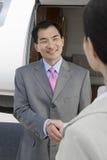 Business Handshake At Airfield Stock Photo