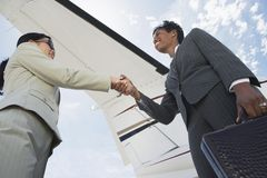 Business Handshake At The Airport Royalty Free Stock Photo