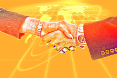 Business handshake on background with global network map. Business handshake on yellow background with global network map stock photos