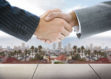 Business handshake on background of townscape Royalty Free Stock Photography