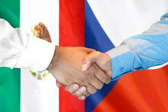 Handshake on Mexico and Czech Republic flag background. Business handshake on the background of two flags. Men handshake on the background of the Mexico and royalty free stock image