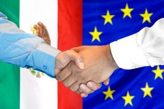 Handshake on Mexico and European Union flag background. Business handshake on the background of two flags. Men handshake on the background of the Mexico and royalty free stock photography