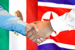 Handshake on Mexico and North Korea flag background. Business handshake on the background of two flags. Men handshake on the background of the Mexico and North royalty free stock photos