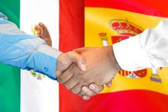 Handshake on Mexico and Spain flag background. Business handshake on the background of two flags. Men handshake on the background of the Mexico and Spain flag stock photography