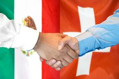 Handshake on Mexico and Switzerland flag background. Business handshake on the background of two flags. Men handshake on the background of the Mexico and stock images