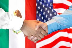 Handshake on Mexico and US flag background. Business handshake on the background of two flags. Men handshake on the background of the Mexico and United States of stock images