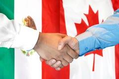 Handshake on Mexico and Canada flag background. Business handshake on the background of two flags. Men handshake on the background of the Mexico and Canada flag stock photos