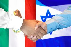 Handshake on Mexico and Israel flag background. Business handshake on the background of two flags. Men handshake on the background of the Mexico and Israel flag royalty free stock photography