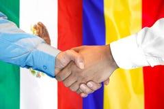 Handshake on Mexico and Moldova flag background. Business handshake on the background of two flags. Men handshake on the background of the Mexico and Moldova royalty free stock images