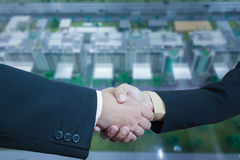 Business handshake with blur background of business buildings ar Royalty Free Stock Photos