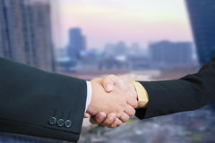 Business handshake with blur background of business buildings ar Royalty Free Stock Images