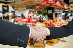 Business handshake with blur background of shopping mall market Stock Photo