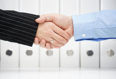 Business handshake  with blurred binders in backround Stock Image