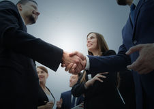 Business handshake. Business handshake and business people conce. Group of business people congratulating their handshaking colleagues after signing contract Stock Photos