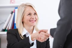 Business handshake. Business handshake and business people concept. Successful Business woman smiling friendly royalty free stock photos