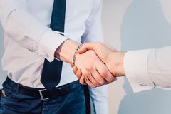 Business handshake. Business handshake and business people concept. Two men shaking hands over sunny office background. Royalty Free Stock Photography