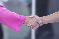 Business handshake. Business man giving a handshake to close the Royalty Free Stock Images