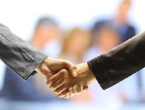 Handshake and business people Stock Images