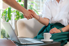 Business handshake and business people. Business achieve concept. Business woman shaking hands during a meeting in the office, success, dealing, greeting and Stock Images