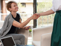 Business handshake and business people. Business achieve concept. Business women shaking hands during a meeting in the office, success, dealing, greeting and Stock Image